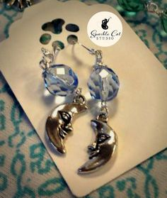 BLUE MOON earrings with light sapphire Czech glass by SparkleCatStudio.  25% of proceeds donated to animal rescues: The Humane Society of Alamance County OR The Biscuit Foundation.  Find us on Facebook and Instagram!
