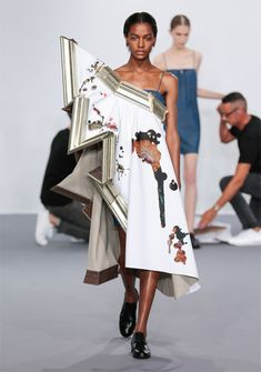 Viktor & Rolf dresses models in wearable paintings during Paris couture show.