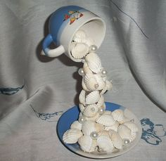 Crafts from shells. Ideas and workshops. DIY crafts from shells: where and how to apply shells brought from the sea DIY Christmas tree toys from shells Sea Crafts, Seashell Crafts, Christmas Tree Toy, Christmas Crafts, Cup And Saucer Crafts, Plastic Spoon Crafts, Floating Tea Cup, Tea Cup Art, Teacup Crafts