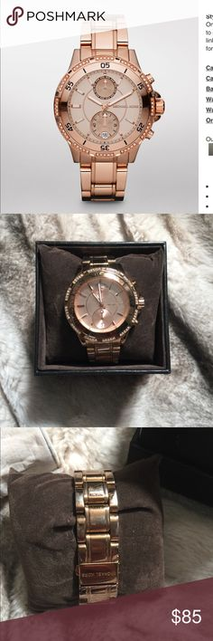 Michael Kors Rose Gold-Tone Garrett Watch Michael Kors Rose Gold-Tone Garrett Watch.  41MM face.  Wear on the band. One small knick on the face of the watch, shown in the last picture.  Still a great accessory! Michael Kors Accessories Watches