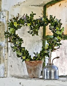 Heart shaped wreath.  I've been looking for a use for a Victorian plantpot and heart shaped wreath former.  This could be perfect!