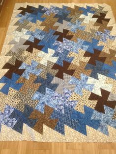 """Twister Quilt Twin size Twister Ruler quilt. I think I have the math down for a twister quilt... With 10"""" blocks and a 6"""" border the quilt ends up 77% smaller than the starting size. So this quilt started out 7x10 - 10"""" blocks plus a 6"""" border all the way around.  So it was 77.5"""" x 106"""" before using the twister ruler.  Finished size before borders is now 60"""" x 82"""" which is .77 times original size.  Hope that helps if you are trying to make a certain size twister quilt."""