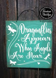 Dragonflies appear when angels are near. This sign is hand painted to look rustic on 12x 12 outdoor plywood and comes with a wire hanger on top for easy hanging. Pictured above in our Laguna background. Need to see the color choices? Click here: