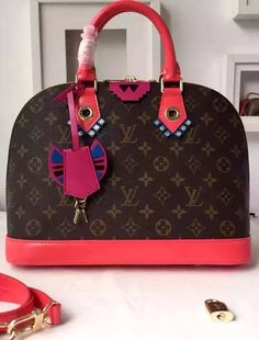 Adorned with artwork and fun elements in vibrant colors, this limited capsule edition of the Alma PM from the Fall/Winter 2015 Monogram Totem collection will definitely turn into a collector's piece. - View Details at: http://www.luxtime.su/louis-vuitton-monogram-totem-alma-PM-flamingo-m41661