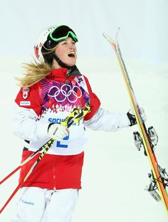 SOCHI, RUSSIA - FEBRUARY 08: Justine Dufour-Lapointe of Canada celebratres after winning the Ladies' Moguls Final during day 1 of the Sochi 2014 Winter Olympics at Rosa Khutor Extreme Park on February 8, 2014 in Sochi, Russia. (Photo by Ryan Pierse/Getty Images)
