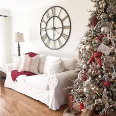 @homebyally has her #livingroom all ready for Christmas, and right smack-dab-in-the-middle is our Addison Open Face #WallClock. With its clean design and bronze finish, this clock transitions from season to season easily and fits in easily with her holiday style! If you want to add this home decor staple to your walls, then shop the link in our profile! #myKirklands #clock #interiordesign #homedecor #walldecor #homeinspo
