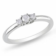 Celebrate your love and commitment with this charming ring! Beautifully crafted of fine sterling silver, this sleek and simple ring is set with three shimmering round diamonds totaling 1/5 ct. Makes the perfect promise ring!
