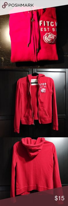 """Abercrombie & Fitch full zip up hoodie Red Abercrombie & Fitch full zip up hoodie with """"FITCH/ EST 92"""" written in white on the front in a size M No defects  Smoke free home/ I do have a cat, but all items have been washed Washed with Tide Pods in Spring Meadow  Price firm unless 3+ items bundled/ No holds/ No trades Check out my other listings for more Pandora items and exclusives! Abercrombie & Fitch Tops Sweatshirts & Hoodies"""
