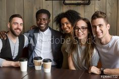 Portrait of multicultural millennial young friends looking at camera, happy multiracial people group having fun in coffeehouse together, diverse african and caucasian students bonding at cafe meeting Coffeehouse, Royalty Free Photos, Bond, Have Fun, Students, Clip Art, African, Stock Photos, Group