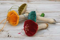 These cute Christmas ornaments are made from fabric swatches and decorated with seed beads. Visit the blog for the free sewing pattern and to see many more DIY fabric mushrooms including denim ones.