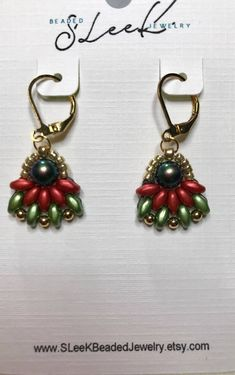Bead woven Christmas super duo beaded earrings with Swarovski dark green pearls. Gold plated lever backs are used. Gold seed beads.