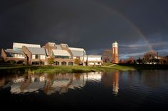 Triple rainbow arching over Grand Valley's Allendale Campus, creating a dramatic photo of the Cook Carillon tower.  Photo by Bernadine Carey Tucker.