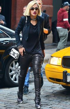 edgy outfit, which consisted of black leather pants, a long dark blue T-shirt, matching blue cropped blazer and cool silver-capped buckled Louboutin boots  Read more: http://www.dailymail.co.uk/tvshowbiz/article-2405171/Rita-Ora-cements-status-fashion-icon-making-enjoys-rockstar-outing-New-York-City.html#ixzz2dOdLf7JA  Follow us: @MailOnline on Twitter | DailyMail on Facebook