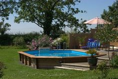 """Sunken above ground pool with deck.  I   would be perfectly content with this """"in-ground"""" pool!!!"""