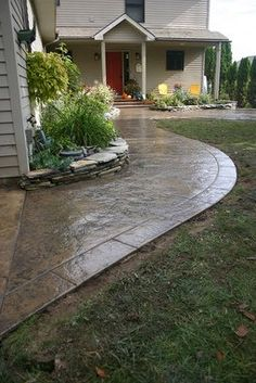 Seamless stamped concrete patio and sidewalk with segmented hand-tooled border - Pebble Davis Integral color with storm gray antiquing release agent.