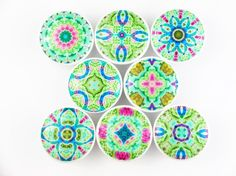"""All of our knobs are handmade to order so please expect 1-3 business days to shipment Set of 8 Gaia mandala print wood drawer knobs These wood knobs are 1.5"""" wide and have been painted white with a de"""