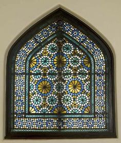 Colored-glass window  Date: 19th century Culture: Iran  Period: Qajar period  Dimensions: Overall: 56 1/2 x 47 7/16 in. (143.5 x 120.5cm)  Medium: Colored glass,