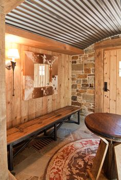 This was my basement dream - several different rustic elements together, including corragated steel.  Love the cowhide frame - have never seen one before!  Love the rock wall.  Can still add some of this.
