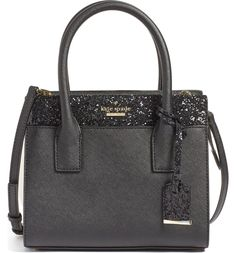 This compact satchel dazzles and delights with glittering trim, polished Kate Spade hardware and a chic, cosmopolitan silhouette.