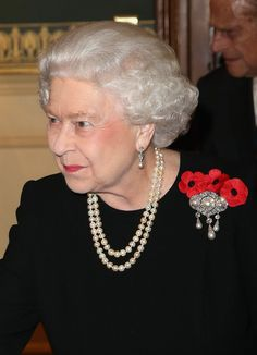 Queen Elizabeth II arrives at the Royal Albert Hall during the Annual Festival of Remembrance on November 7, 2015 in London. The Queen was wearing the Queen Alexandra's Wedding Brooch.