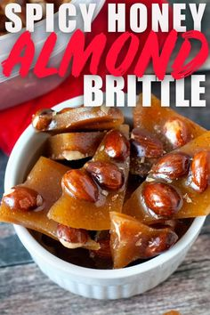 This Spicy Honey Almond Brittle recipe might be life-changing. It's easy enough to make for Christmas goodie plates and the recipe uses no corn syrup! But the best part is that you add a little bit of cayenne pepper to it! The cayenne just warms up the back of your throat and makes you want more. So addicting and so, so good! #brittle #almonds #honey #cayenne via @heatherlikesfood