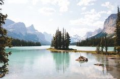 Spirit Island in Maligne Lake is such a beautiful place to spend an afternoon. It's a mile) round trip canoe ride to the island that takes between hours and is worth every stroke! I've been loving the summer vibes here in Canada Banff National Park, National Parks, Nature Photography, Travel Photography, Earth Photos, Adventure Is Out There, Amazing Destinations, The Great Outdoors, Beautiful Places