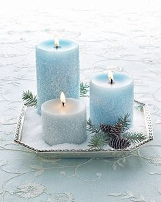 Candle centerpiece. Silver tray, pine needles, pine cones, blue candles, fake snow
