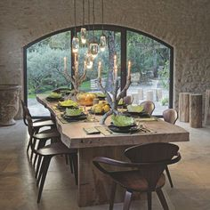 Rustic dining room dressed in stone and its large wooden table - Côté Maison - Pctr UP French Interior, Interior Design, Old Home Remodel, Sweet Home, Wooden Dining Tables, Dining Room Lighting, Dining Area, House Design, House Styles