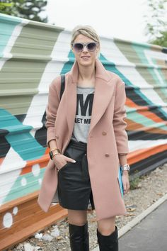 pink coat meets black leather (©Getty Images)
