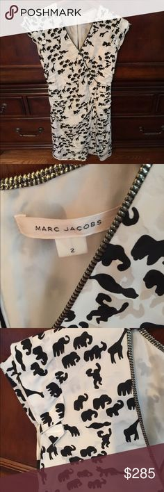 Marc Jacobs Animal Print Dress! In excellent condition.  Print has elephant, monkey, giraffe etc. Zipper detail on front and back of dress Marc Jacobs Dresses Midi