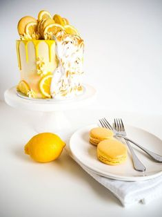 Coconut Lemon Meringue Cake - Moist and light coconut cake with tangy lemon curd, fluffy coconut lemon buttercream and pillows of cascading toasted meringue
