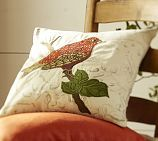 I love these embroidered pillow covers.  Just unbutton the back and wash.