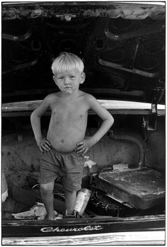 Small shirtless boy standing in trunk of car with hands on hips.. From Duke Digital Collections. Collection: William Gedney Photographs and Writings.