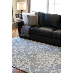 @Overstock - Hand Tufted Grey Floral Rug. Warm up a cold floor with this pretty hand-tufted floral rug. With a gray background and white highlights, this piece is delightfully elegant yet neutral enough to match your decor. The poly-acrylic construction ensures durability in high-traffic areas.http://www.overstock.com/Home-Garden/Hand-tufted-Grey-Floral-Rug/5509808/product.html?CID=219283