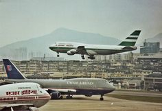 Hong Kong-Kai Tak International Airport with 3 generations of the Boeing 747 present: Air India Boeing 747-200B, United Airlines Boeing 747-422, and Cathay Pacific Boeing 747-367