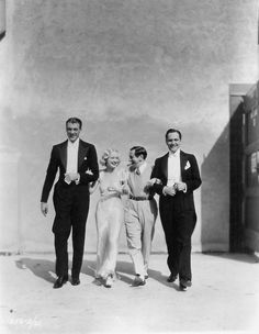 Gary Cooper, Miriam Hopkins, Ernst Lubitsch, Fredric March on the set of Design for Living.