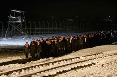 About 1.5 million people, most of them Jews, were killed at the Nazi camp which has become a symbol of the horrors of the Holocaust and WWII. Here, delegation and survivors make their way through Auschwitz concentration camp to lay candles at the Birkenau Memorial in Oswiecim, Poland on Jan. 27, 2015.