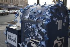 STREET ART TAKES ON NATURE    Swarms of paper artist, Tasha Lewis's beautiful blue & white butterflies are being spotted all over the darnest things in her hometown of Indianapolis. Guerilla Sculpture, the name of the project is all about creating random acts of nature in an urban environment.