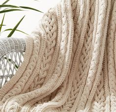Free Knitting Pattern for Braided Cables Throw - This blanket knitted in Bernat Maker Home Dec features three different kinds of cable braids so you never get bored. Quick knit in bulky yarn.