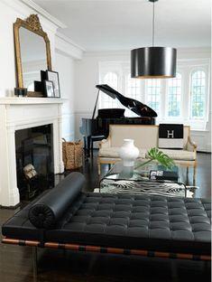 B & W, Gilded Settee, Zebra Rug, Black Modern Chaise, Hermes Blanket, and Baby Grand Piano, so Chic.