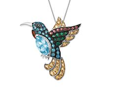 From our 'Rainbow Topaz' Collection: Hummingbird Pendant features ice blue, paraiba, honey, rainforest, poppy and pink natural topaz totaling 2 5/8 ct