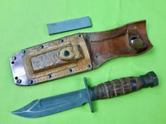 Vintage 1986 US Ontario Jet Pilot Survival Fighting Knife with Leather Sheath and Sharpening Stone Guard is loose Size: 10 total length, the blade is Survival Knife, Survival Skills, Leather Knife Sheath Pattern, Sharpening Stone, Knifes, Blacksmithing, Ontario, Weapons, Blade