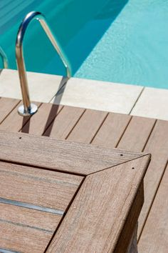 UPM ProFi Lifecycle Walnut used for pool in Annecy Le Vieux, France. Gaps between decks are covered with UPM's own Design Rubber Strip.