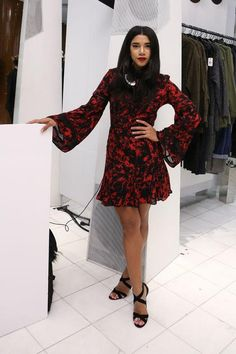 When it comes to Valentine's Day date outfit ideas, you can never go wrong with classic red (and we love how Hannah Bronfman made the shade extra trendy with bell sleeves). Click for more outfit ideas!