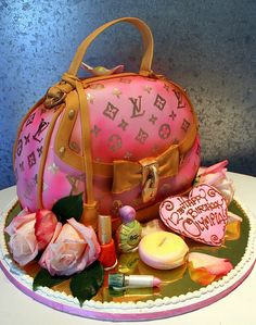 Cakes ~ Louis Vuitton Bag Birthday Cake~  3-D cake as Vuitton bag. All edible decoration. White chocolate lipstick, nail polish compact etc.