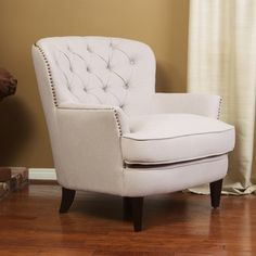 @Overstock.com - Christopher Knight Home Tafton Tufted Fabric Club Chair - This tan fabric club chair combines the comfort of a soft seat and cushion with the timeless style of tufted linen upholstery and solid, sturdy, espresso-colored wooden legs. Its wide back and seat give ample room for people of all sizes to sit.  http://www.overstock.com/Home-Garden/Christopher-Knight-Home-Tafton-Tufted-Fabric-Club-Chair/6045249/product.html?CID=214117 $330.99