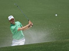 Martin Kaymer, of Germany, hits out of a bunker on the second hole during the fourth round of the Masters golf tournament Sunday, April 13, ...