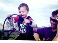 Spencer on tractor when he was about 2