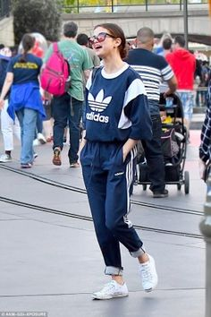 Selena Gomez wearing Adidas Originals Colorblock Track Pants in Navy, Adidas Originals Trefol Sweatshirt and Converse x Jack Purcell Low Profile Lace-Up Sneakers