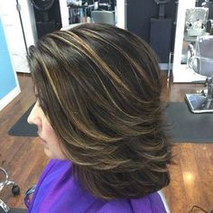 medium layered hairstyle with highlights...love the little back flip. Sleek and simple!